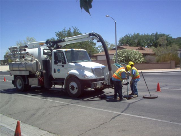 Vactor Truck Crew Maintaining Wastewater Lines